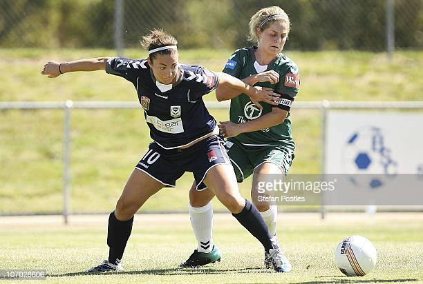 Ellie Brush of Canberra and Jodie Taylor of the Victory challenge for the ball during the round three WLeague match between Canberra United and the...