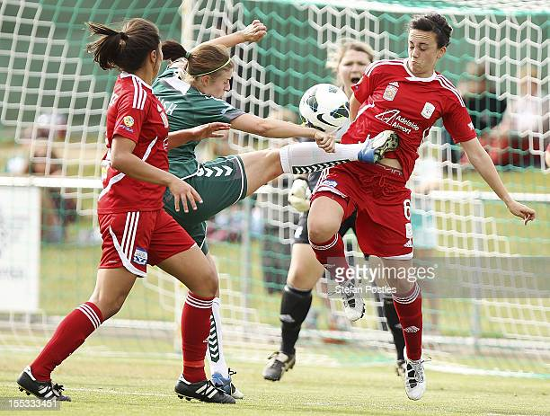 Ellie Brush of Canberra United and Cassandra Tsoumbris of Adelaide United contest possession during the round three WLeague match between Canberra...