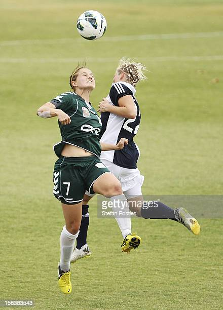 Ellie Brush of Canberra United and Jessica Fishlock of Melbourne Victory contest possession during the round nine W-League match between Canberra...