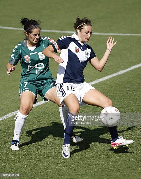 Ellie Brush of Canberra United and Jodie Taylor of Melbourne Victory contect possession during the round four WLeague match between Canberra United...