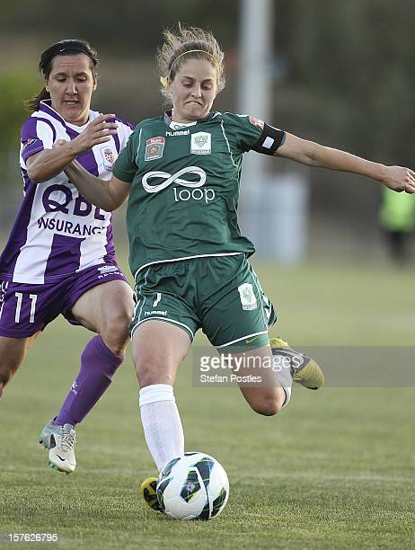 Ellie Brush of Canberra United and Lisa De Vanna of Perth Glory contest possession during the round six W-League match between Canberra United and...