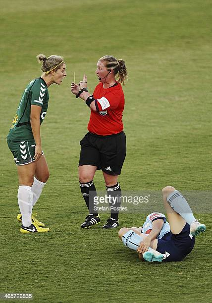Ellie Brush of Canberra United is shown a yellow card after a tackle on Amy Harrison of Sydney FC during the round three WLeague match between...