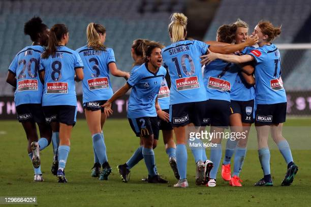 Ellie Brush of Sydney FC celebrates with her team mates after scoring a gold during the round four W-League match between Sydney FC and the Western...