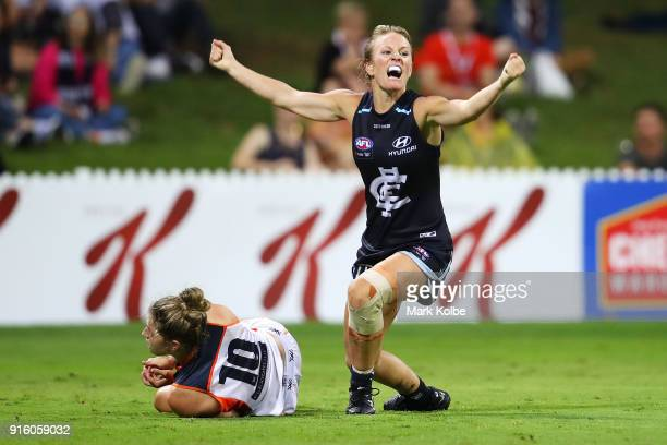 Ellie Brush of the Giants looks dejected as Katie Loynes of the Blues celebrates scoring a goal during the round 20 AFLW match between the Greater...