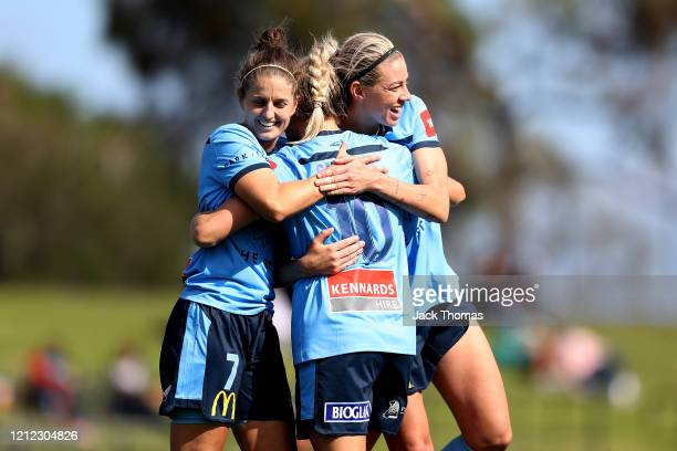 Ellie Brush, Remy Siemsen and Alanna Kennedy of Sydney FC during the W-League Semi Final match between the Melbourne Victory and Sydney FC at Epping...