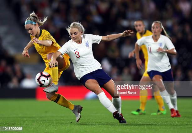 Ellie Carpenter of Australia battles for posession with Alex Greenwood of England Women during the International Friendly match between England Women...
