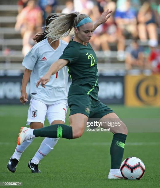 Ellie Carpenter of Australia passes in front of Emi Nakajima of Japan during the 2018 Tournament Of Nations at Toyota Park on August 2 2018 in...