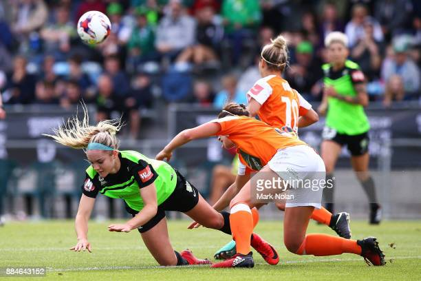 Ellie Carpenter of Canberra and Celeste Boureille of the Roar contest possession during the round six WLeague match between Canberra United and the...