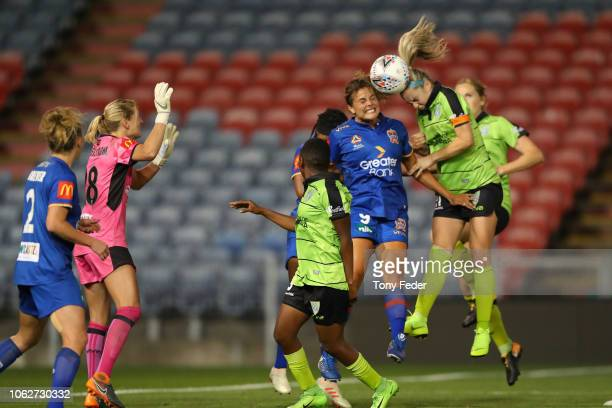 Ellie Carpenter of Canberra and Katherine Stengel of the Jets contest a header during the round three WLeague match between the Newcastle Jets and...