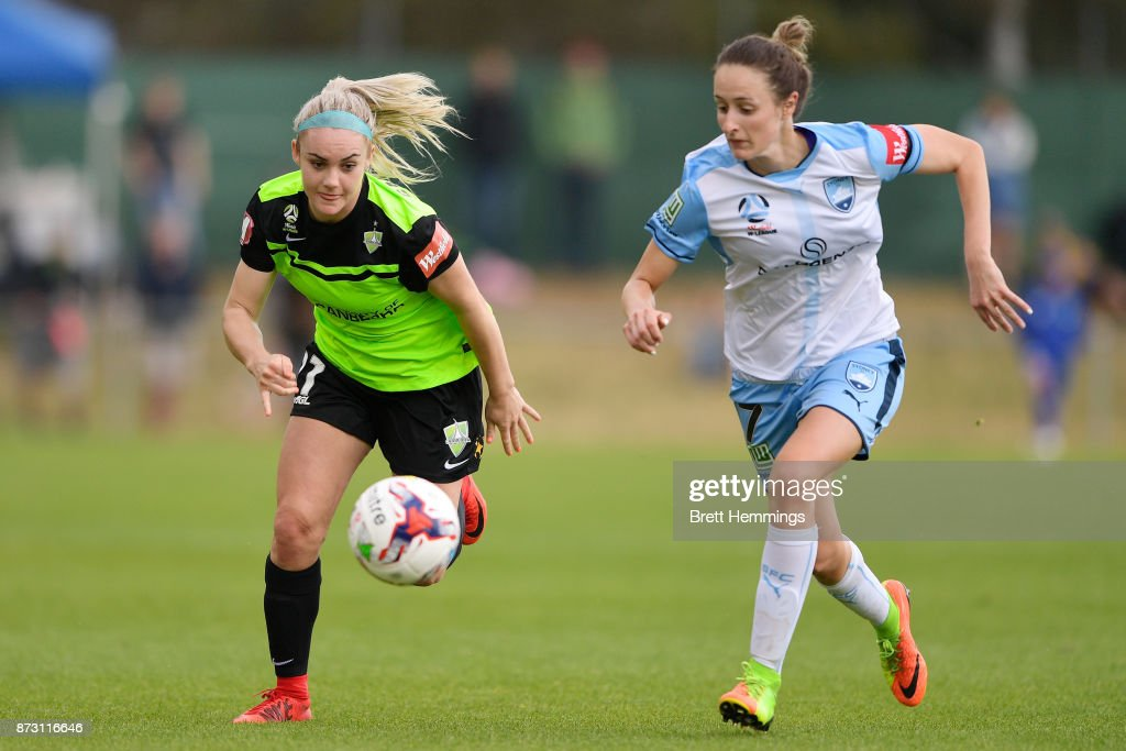 Ellie Carpenter of Canberra and Rachel Soutar of Sydney contest the ball during the round three W-League match between Canberra United and Sydney FC at McKellar Park on November 12, 2017 in Canberra, Australia.