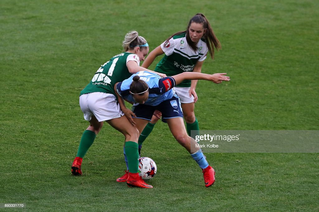 Ellie Carpenter of Canberra United and Caitlin Foord of Sydney FC compete for the ball during the round eight W-League match between Sydney FC and Canberra United at Allianz Stadium on December 15, 2017 in Sydney, Australia.