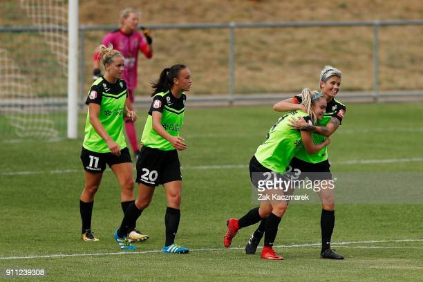 Ellie Carpenter of Canberra United celebrates with Michelle Heyman of Canberra United after scoring a goal during the round 13 WLeague match between...