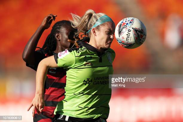 Ellie Carpenter of Canberra United is challenged by Elizabeth Addo of the Wanderers during the round six W-League match between the Western Sydney...