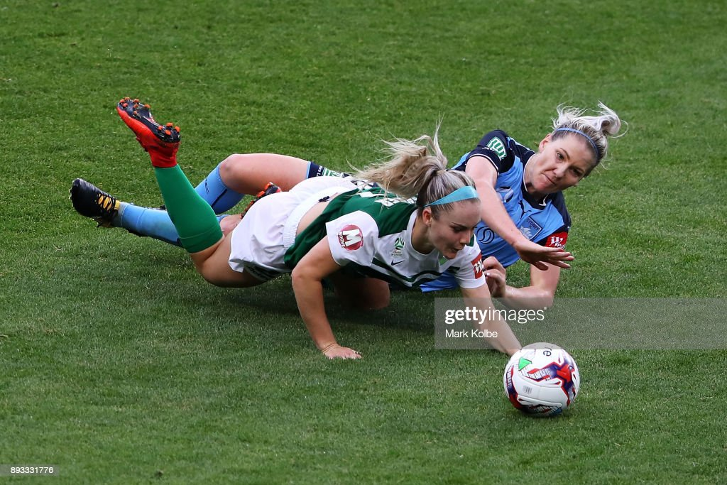 Ellie Carpenter of Canberra United is tackled by Caitlin Cooper of Sydney FC during the round eight W-League match between Sydney FC and Canberra United at Allianz Stadium on December 15, 2017 in Sydney, Australia.