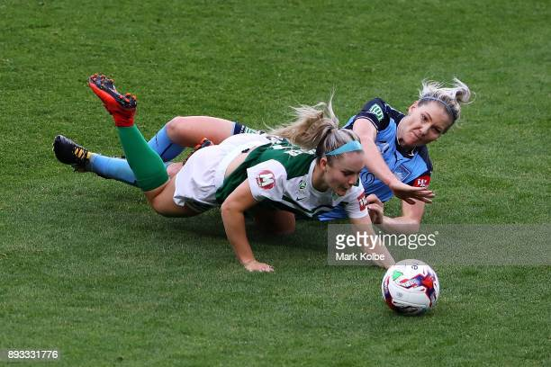 Ellie Carpenter of Canberra United is tackled by Caitlin Cooper of Sydney FC during the round eight WLeague match between Sydney FC and Canberra...