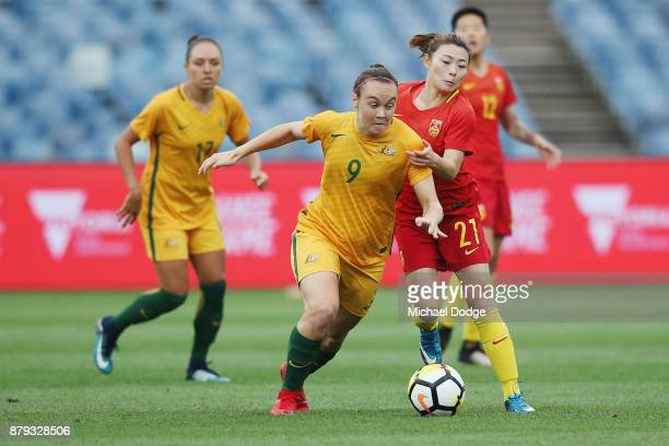Ellie Carpenter of the Matildas is pulled back by Xu Yanlu of China PR during the Women's International match between the Australian Matildas and...