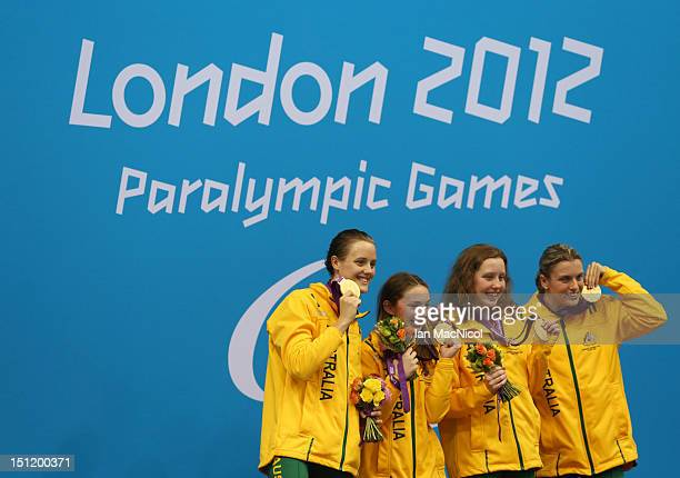 Ellie Cole Maddison Elliot Katherine Downie and Jacqueline Freney of Australia pose on the podium during the medal ceremony for the Women's 4x100m...