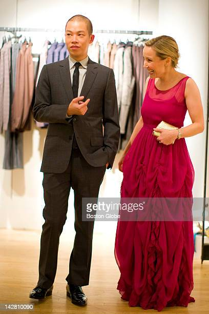 """Ellie Cornish of Boston, wore a red dress by designer Jason Wu, left. A busload of famous New York designers and their """"muses"""" arrived at Louis..."""