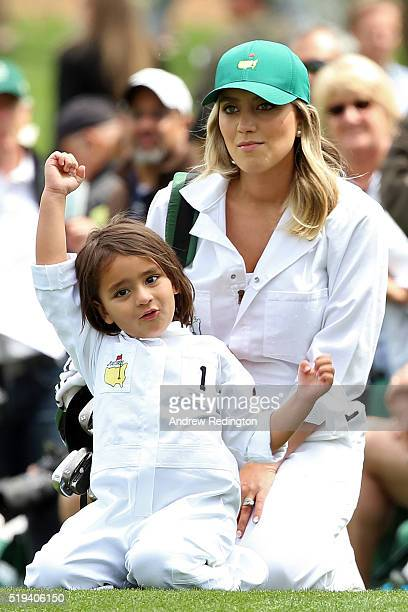 Ellie Day holds her son Dash during the Par 3 Contest prior to the start of the 2016 Masters Tournament at Augusta National Golf Club on April 6 2016...