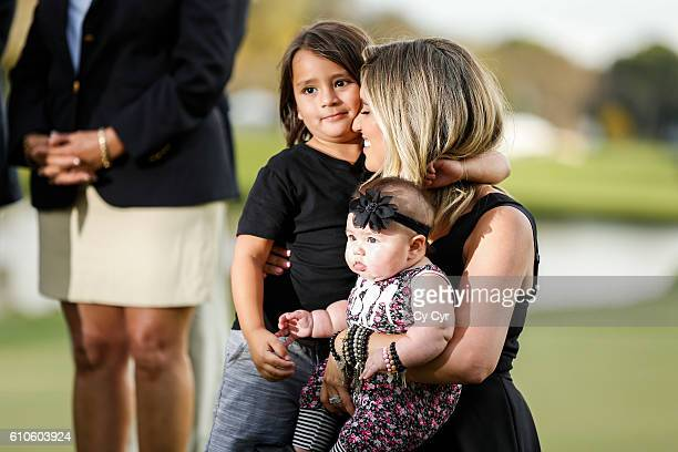Ellie Day wife of Jason Day of Australia and their kids Lucy and Dash attend a trophy ceremony following Day's one stroke victory on the 18th hole...