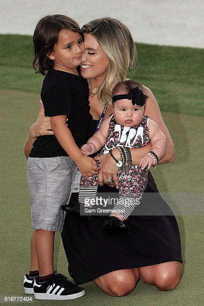 Ellie Day wife of Jason Day of Australia sits with her children Dash Day and Lucy Day following the final round of the Arnold Palmer Invitational...