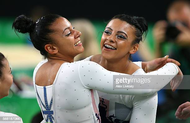 Ellie Downie of Great Britain hugs her sister Becky Downie after completing the Vault during the Artistic Gymnastics Women's Team Final on Day 4 of...