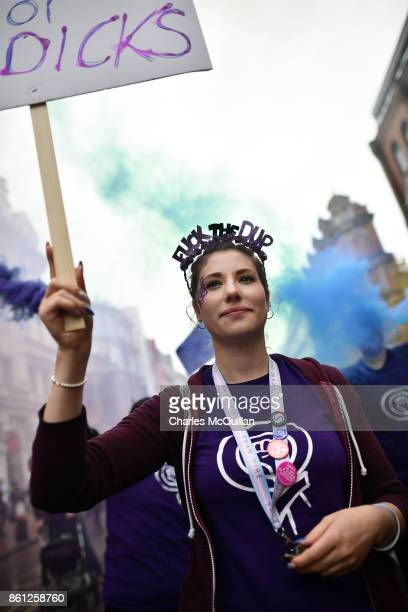 Ellie Evans who has been questioned by police for holding a placard with the slogan 'Fuck the DUP' at a previous Gay Pride march wears a head dress...