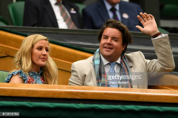 Ellie Goulding and guest look on from the centre court royal box on day eight of the Wimbledon Lawn Tennis Championships at the All England Lawn...