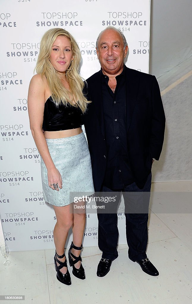 Ellie Goulding (L) and Sir Philip Green attend the Unique SS14 show during London Fashion Week on September 15, 2013 in London, England.