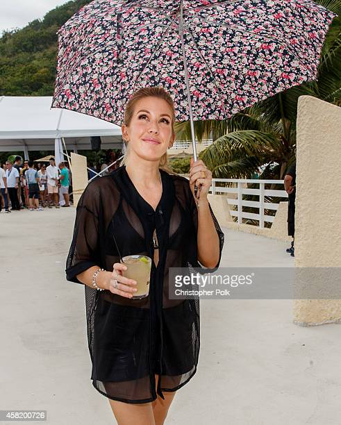 Ellie Goulding covers herself from the rain after a media lunch at the Bacardi Triangle event on October 31 2014 in Fajardo Puerto Rico