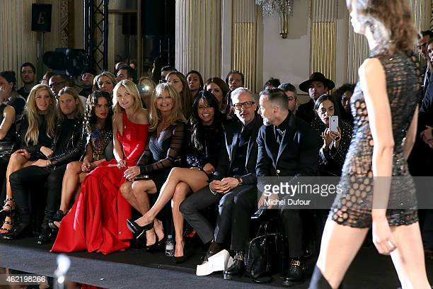 Ellie Goulding, Dougie Poynter, Sophie Lopez, Kate Hudson with her mother Goldie Hawn, Michelle Rodriguez, guest and David Furnish attend the Versace...