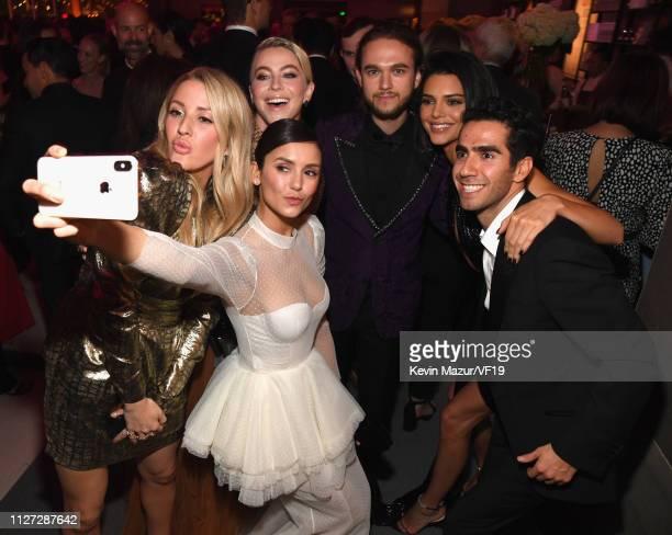 Ellie Goulding Julianne Hough Nina Dobrev Zedd and Kendall Jenner pose for a selfie during the 2019 Vanity Fair Oscar Party hosted by Radhika Jones...