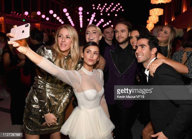 Ellie Goulding Julianne Hough Nina Dobrev Zedd and Kendall Jenner pose for a selfie during the 2019 Vanity Fair Oscar Party hosted by Radhika Jones...