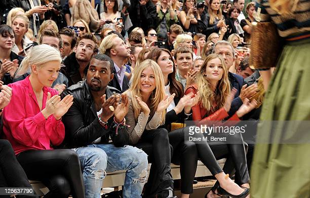 Ellie Goulding Kanye West Sienna Miller Gemma Arterton Rosie HuntingtonWhiteley and Mario Testino attends at the Burberry Spring Summer 2012...