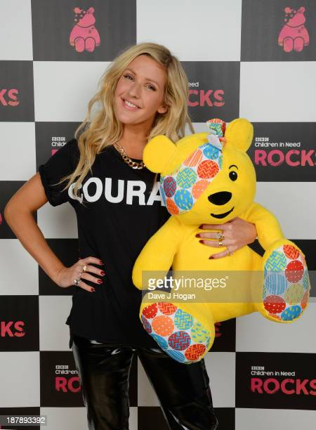 Ellie Goulding poses with Pudsey Bear backstage during the 'BBC Children In Need Rocks' at Hammersmith Eventim on November 13 2013 in London England...