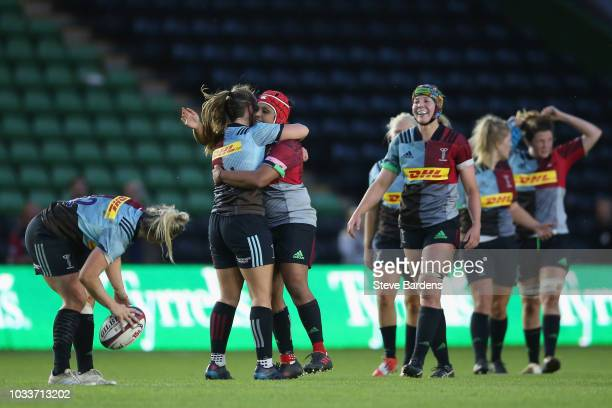 Ellie Green of Harlequins Ladies is congratulated by her team mates after kicking a conversion to secure a draw during the Tyrrells Premier 15s match...