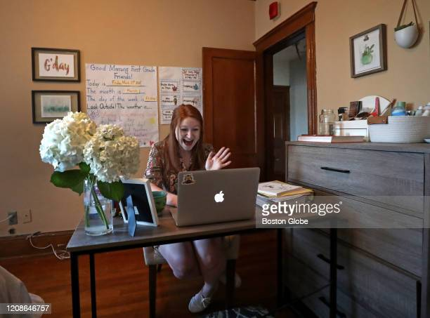 Ellie Lyons an elementary school teacher meets with her Natick firstgrade students on Google Meet from her home in Brookline MA on March 27 2020 She...