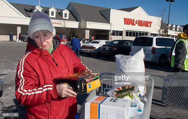 Ellie Mahoney loads her purchases into her car at a Wal-Mart store in Framingham, Massachusetts, U.S. On Thursday, Dec. 6, 2007. U.S. Economic growth...
