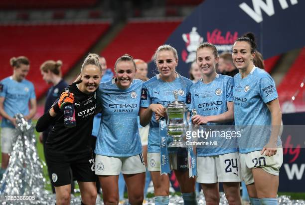 Ellie Roebuck, Georgia Stanway, Alex Greenwood, Keira Walsh and Lucy Bronze of Manchester City celebrate with the Vitality Women's FA Cup Trophy...