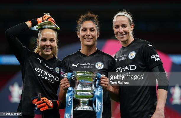 Ellie Roebuck, Karima Benameur Taieb and Karen Bardsley of Manchester City celebrate with the Vitality Women's FA Cup Trophy following their team's...