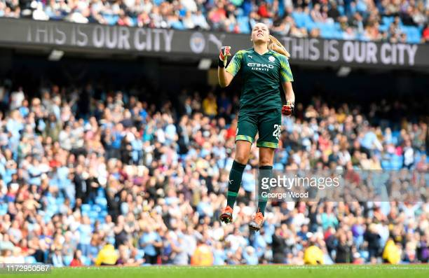 Ellie Roebuck of Manchester City celebrates as Caroline Weir scores her team's first goal during the Barclays FA Women's Super League match between...