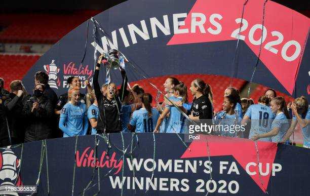 Ellie Roebuck of Manchester City lifts the Vitality Women's FA Cup Trophy following her team's victory in the Vitality Women's FA Cup Final match...