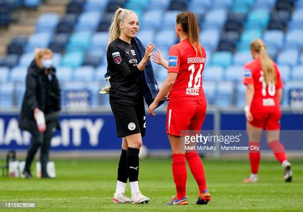 Ellie Roebuck of Manchester City shakes hands with Georgia Brougham of Birmingham City during the Barclays FA Women's Super League match between...