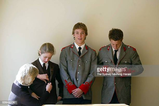 Ellie Scott buttons the Frensham blazer of her daughter Katie Her sons Jamie and John are in the King's School uniform 25 July 2004 SMH Picture by...
