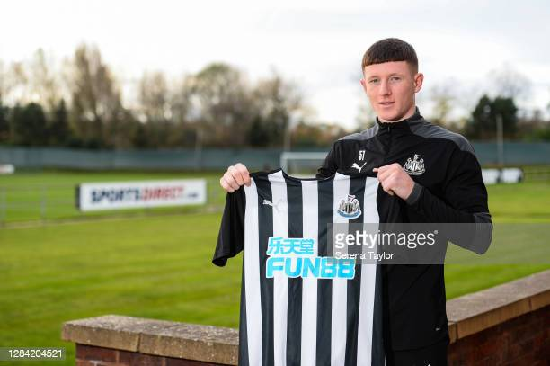 Elliot Anderson poses for photographs as he signs a new contract at the Newcastle United Training Centre on November 06, 2020 in Newcastle upon Tyne,...
