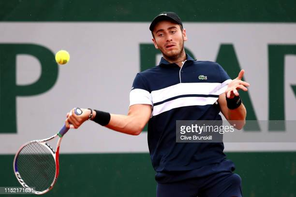 Elliot Benchetrit of France plays a forehand during his mens singles first round match against Cameron Norrie of Great Britain during Day three of...