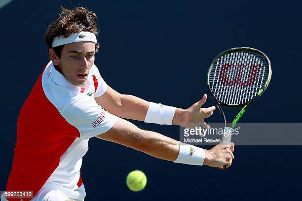 Elliot Benchetrit of France returns a shot to Nicola Kuhn of Spain during his first round Junior Boy's match on Day Seven of the 2016 US Open at the...