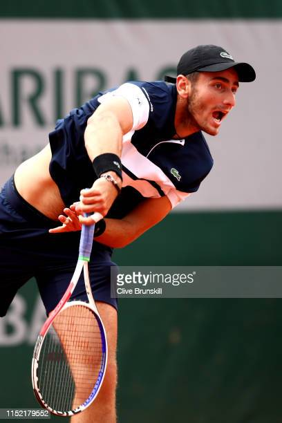 Elliot Benchetrit of France serves during his mens singles first round match against Cameron Norrie of Great Britain during Day three of the 2019...