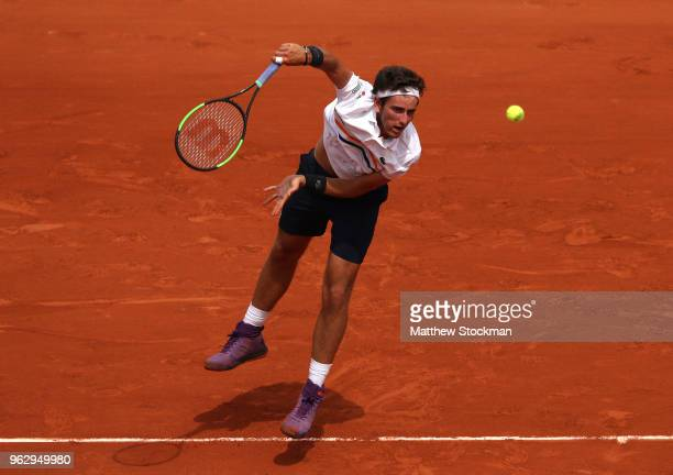 Elliot Benchetrit of France serves during his men'serves singles first round match against Gael Monfils of France during day one of the 2018 French...
