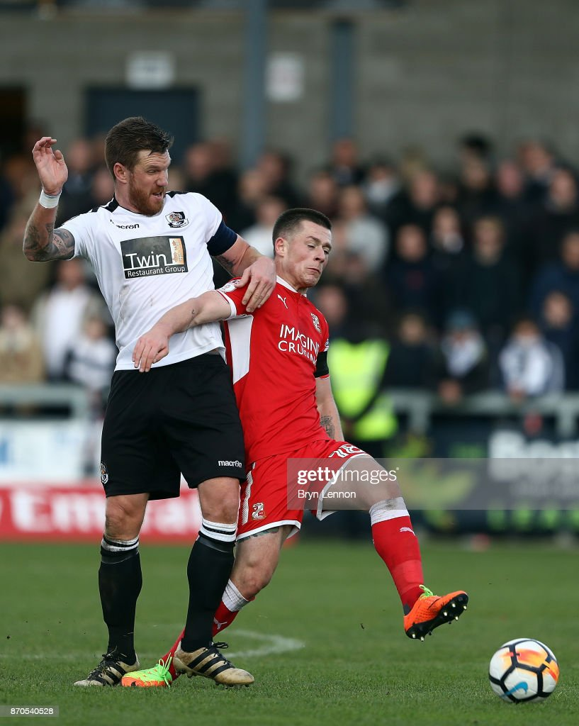 Elliot Bradbrook of Dartford battles with Donal McDermott of Swindon Town during The Emirates FA Cup first round match between Dartford and Swindon Town at the Princes Park Stadium on November 5, 2017 in Dartford, England.